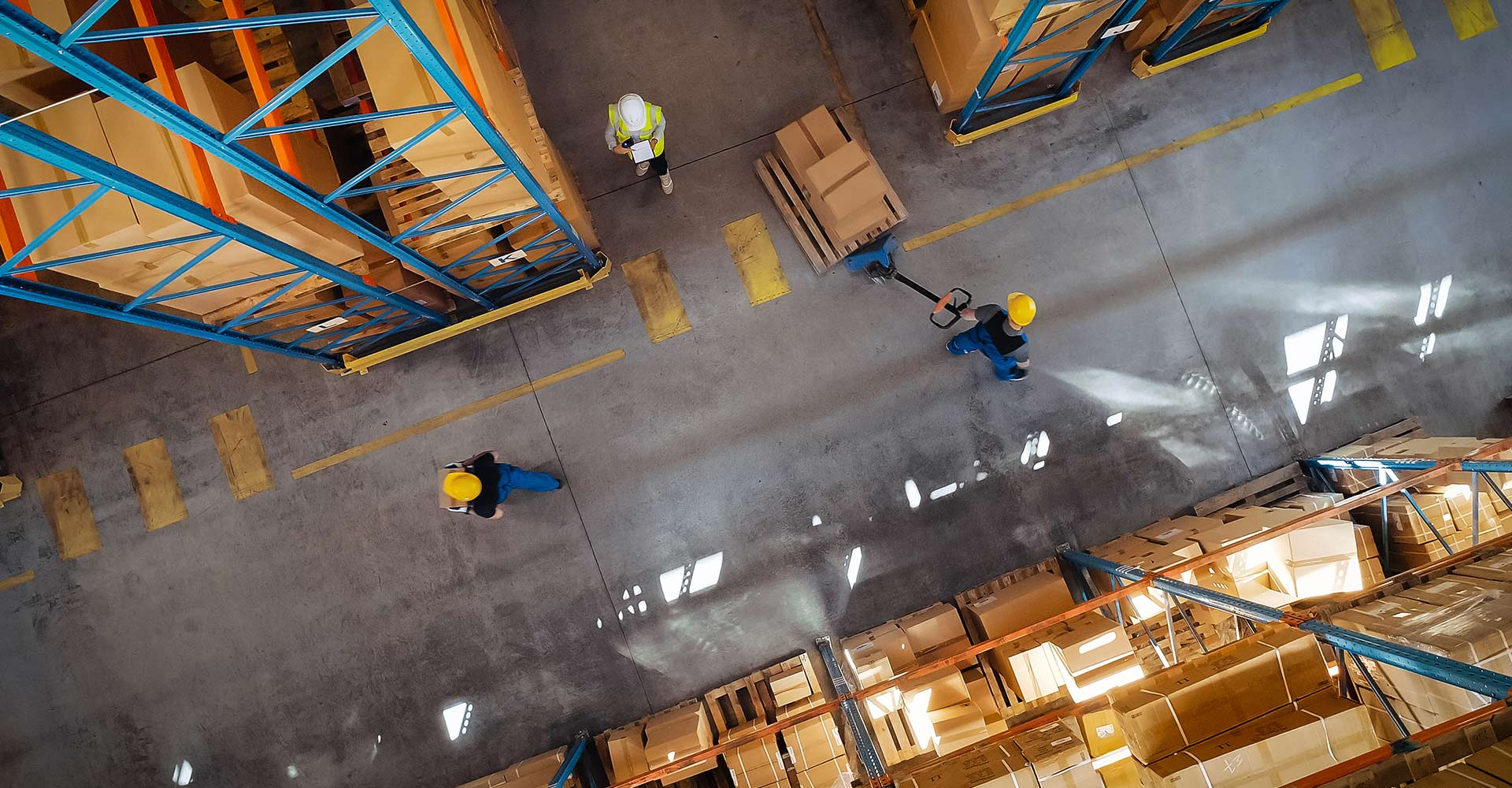 Warehouse workers from bird's eye view.