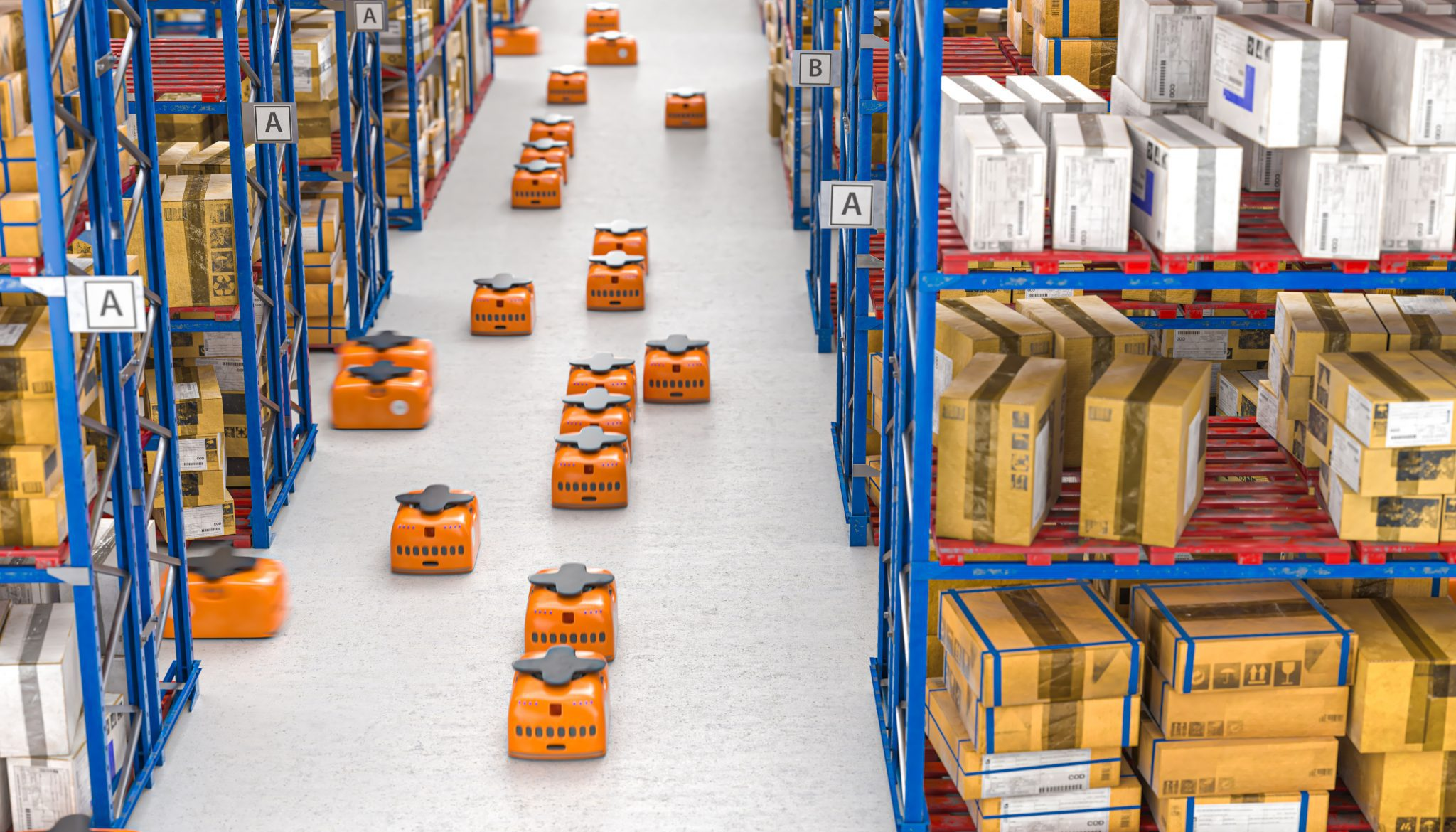 Modern warehouse with AGVs going down aisle.